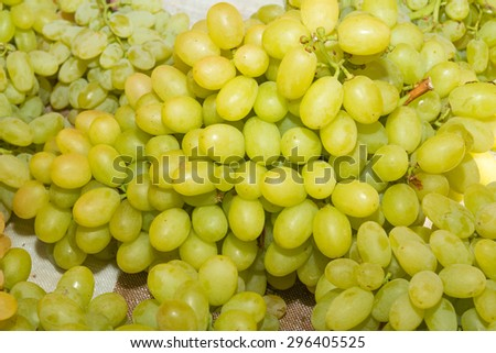 Juicy health booster power health fruit freshly cut white grapes on an open air fruit market stand. - stock photo