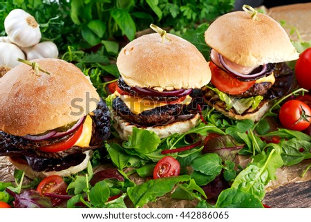 Juicy homemade Burger with beef patty, mushroom and vegetables - stock photo