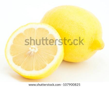 Juicy lemons on white background - stock photo