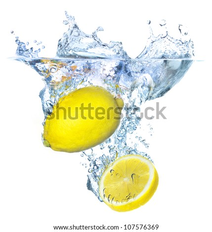 Juicy lemons under bright water splash. Tasty and healthy food - stock photo