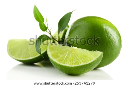 Juicy lime with green with leaves isolated on white - stock photo