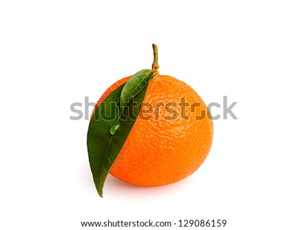 Juicy mandarin with green leaves isolated on white background