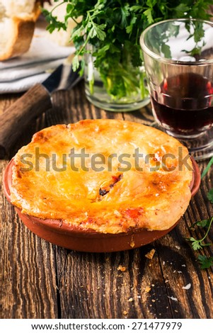 Juicy meat pot pie in a ceramic oven pot, beef stew pie with puff pastry