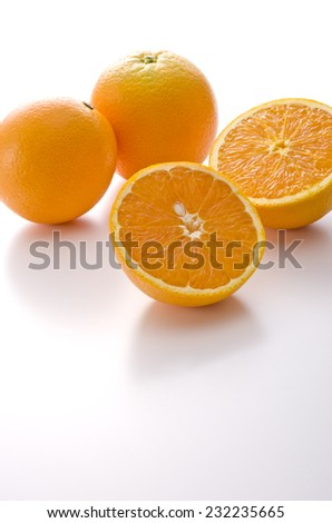 juicy oranges on white background - stock photo
