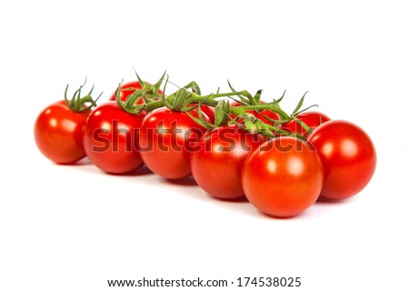 Juicy organic Cherry tomatoes isolated over white background - stock photo