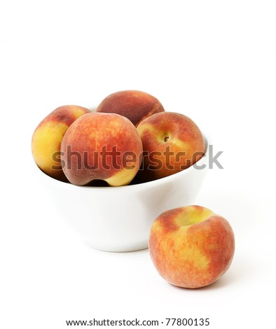juicy peaches in a bowl on white background - stock photo
