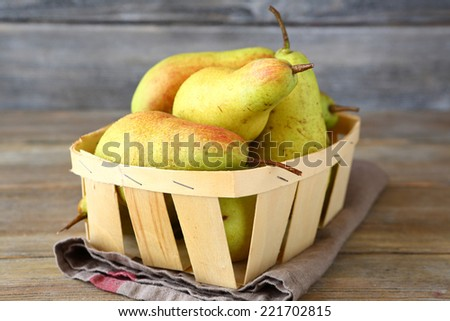 Juicy pears in wooden crate, fruit - stock photo