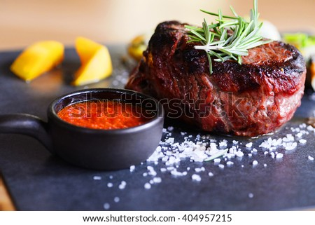 juicy portions of grilled fillet steak  - stock photo