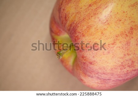 juicy red apple close up, paperboard background - stock photo