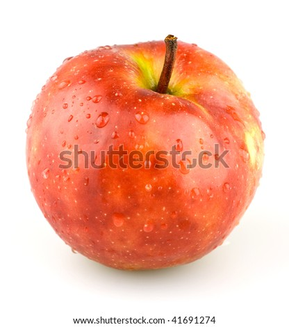Juicy red apple with some water droplets. - stock photo