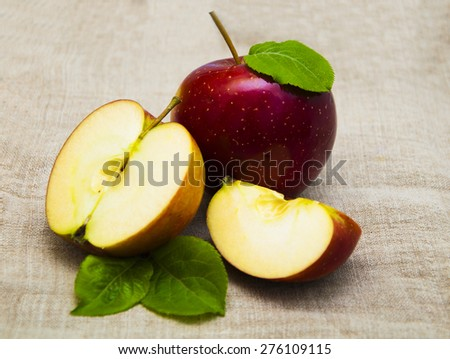 Juicy red apples on a sack background - stock photo
