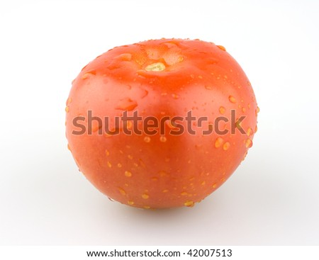 Juicy red tomato with some water droplets. - stock photo