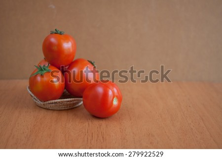 juicy red tomatoes on wooden table
