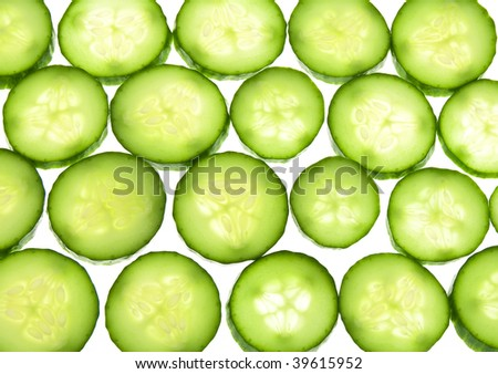 Juicy rings of a cucumber  located on a white background