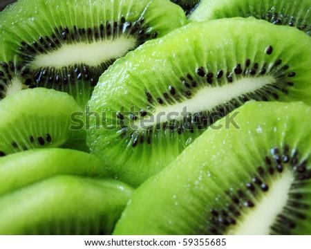 juicy ripe delicious sliced kiwi fruit, close-up - stock photo