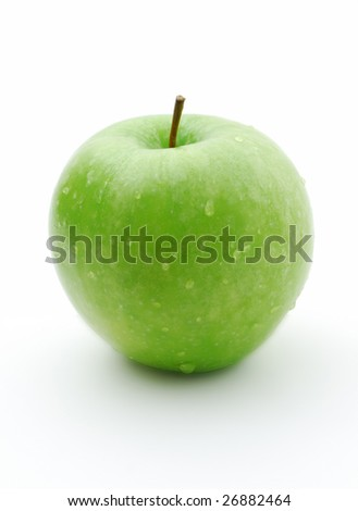 Juicy ripe green apple on a white background