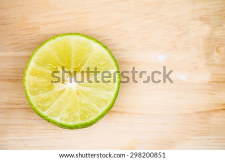 Juicy ripe lemon on wooden table,Top view - stock photo
