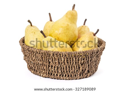 Juicy ripe pears in woven basket, on a white background - stock photo