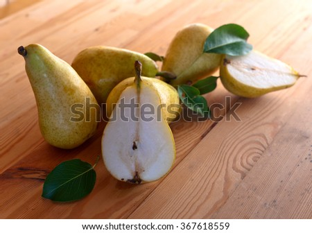 Juicy ripe pears on a wooden table - stock photo