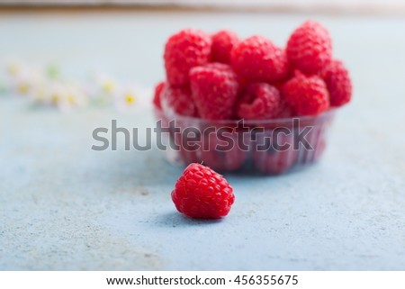 juicy ripe raspberries on the table,selective focus - stock photo