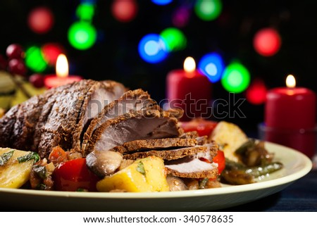 Juicy roast pork on the holiday table. Shallow depth of field - stock photo