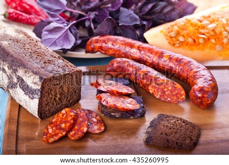 Juicy sausage dish on a natural background. - stock photo