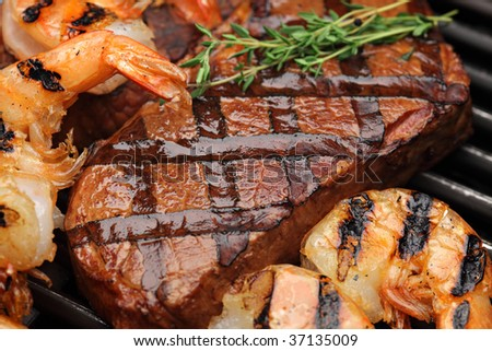 Juicy sirloin steak with grilled shrimps