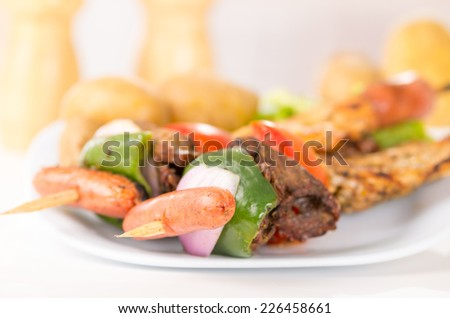 juicy skewers shish kebab sticks grilled meat chicken on a plate closeup selective focus