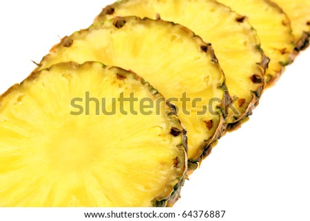 Juicy slices of pineapple, isolated on white background. Studio work.