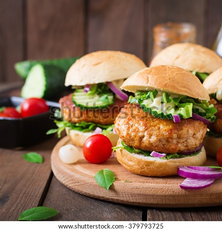 Juicy spicy chicken burgers to Asian-style - sandwich - stock photo