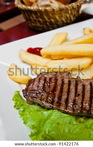 juicy steak beef meat with french fries