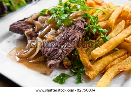 juicy steak beef meat with lettuce and potatoes