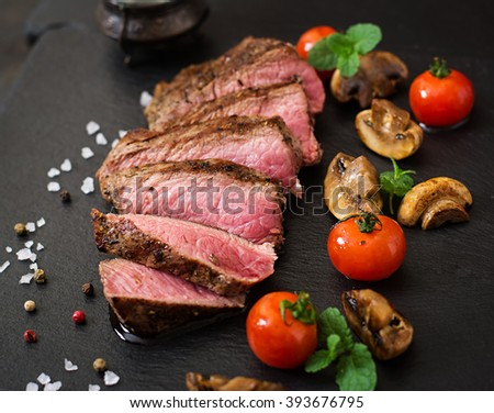 Juicy steak medium rare beef with spices and grilled vegetables - stock photo