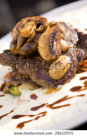 Juicy steak with mushrooms and sauce