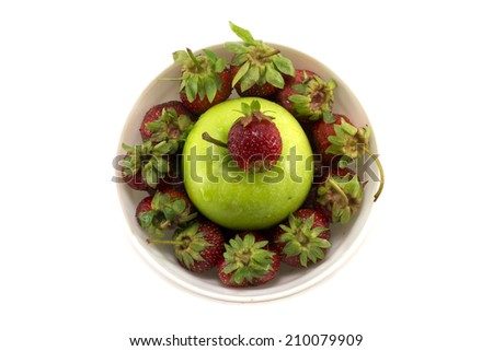 Juicy strawberry with green apple. Isolated object. - stock photo