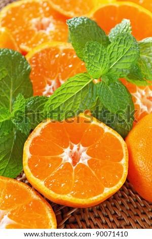 Juicy tangerine and mint - stock photo