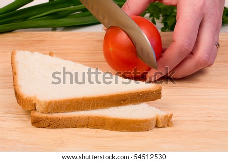 Juicy tomatoes and bread cut on the board