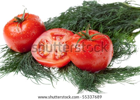 juicy tomatoes on bunch of the dill on white background - stock photo