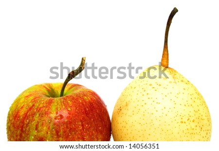 Juicy yellow pear and ripe red apple. Isolated, shallow DOF.