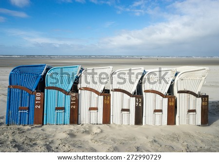 JUIST, GERMANY - APRIL 02: beach chairs on JUIST on APRIL 02, 2015.