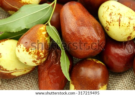 Jujube fruits with leaves closeup - stock photo