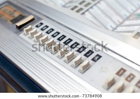 Jukebox buttons with song letters in diagonal composition