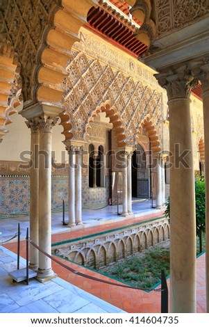 JUL 11 2015: Beautiful Moorish courtyard inside the Alcazar of Seville in Seville, Andalusia, Spain