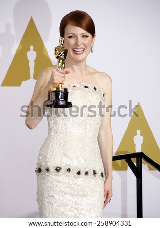 Julianne Moore poses in the press room during the 87th Annual Academy Awards at Loews Hollywood Hotel on February 22, 2015 in Hollywood, California. - stock photo
