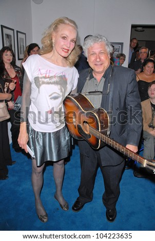 """Julie Newmar and Smokey Miles at Julie Newmar ~A Life in Motion"""" at the David  W. Streets Gallery, Beverly Hills, CA. 11-08-09 EXCLUSIVE - stock photo"""