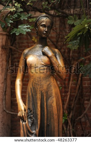 Juliet's staue by the house in Verona claiming to be Juliet's - stock photo