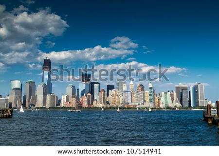 July 2012. Afternoon view of the Freedom Tower and Downtown Manhattan skyline across the Hudson River from the Liberty State Park in Jersey City, NJ. - stock photo