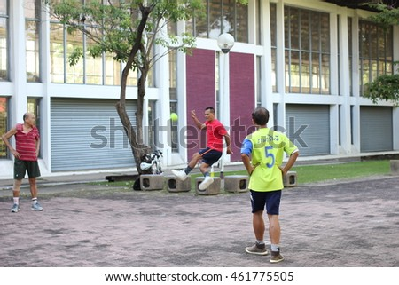"July 31, 2016 : Athletes is playing Hoop takraw ball In thai call ""tra kron ot huang"" is a famous for sport in Thailand at Chatuchak Park in the evening, Bangkok, Thailand on July 31, 2016"