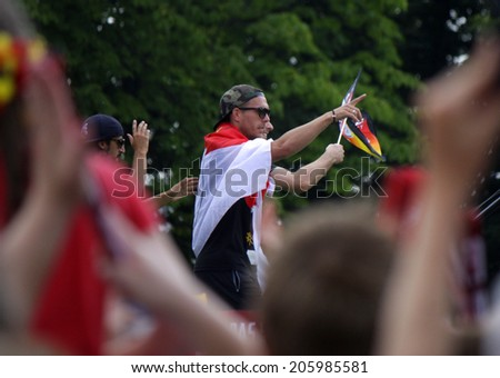 """JULY 15, 2014 - BERLIN: Lukas Podolski - impressions from the """"Fanmeile"""" - reception of the German national team after the win of the football world championship in Brasil 2014. - stock photo"""