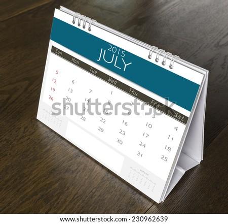 July Calendar  2015 on wood table - stock photo